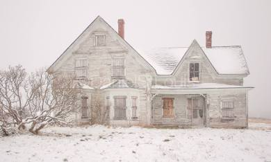 White house in the snow in Advocate Harbour, NS.