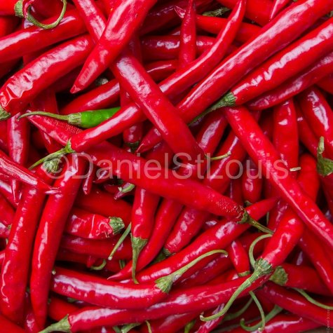 Red peppers in a group.