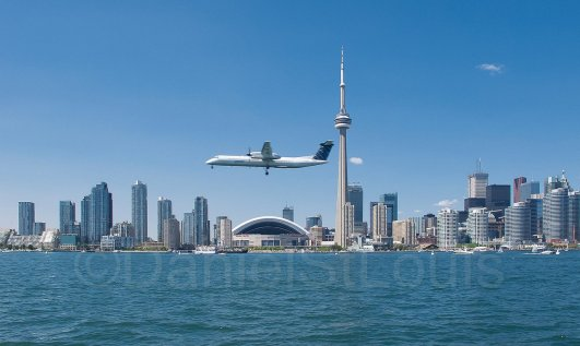 Plane flying into Toronto from the ferry to Toronto Island.
