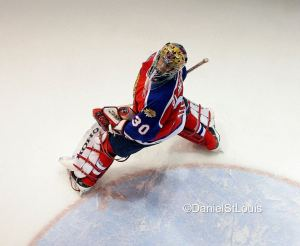 Moncton Wildcats goaltender watches a deflected puck go out of play.