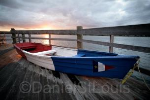 Boat on the dock of Pays de la Sagouine in Acadian colours.