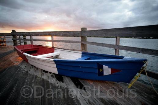 Boat on the dock of Pays de la Sagouine in Acadian colours.