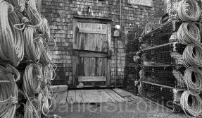 Black and white image of fishing traps and door.