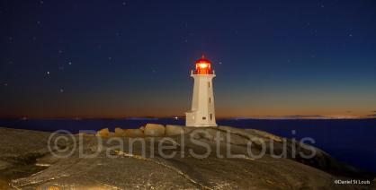 Lighthouse at night on Peggy's Cover, NS
