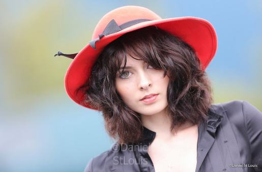 Model wearing red hat in Halifax.