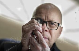 La Mine D'Or gemologist performs a diamond appraisal, a location, working headshot